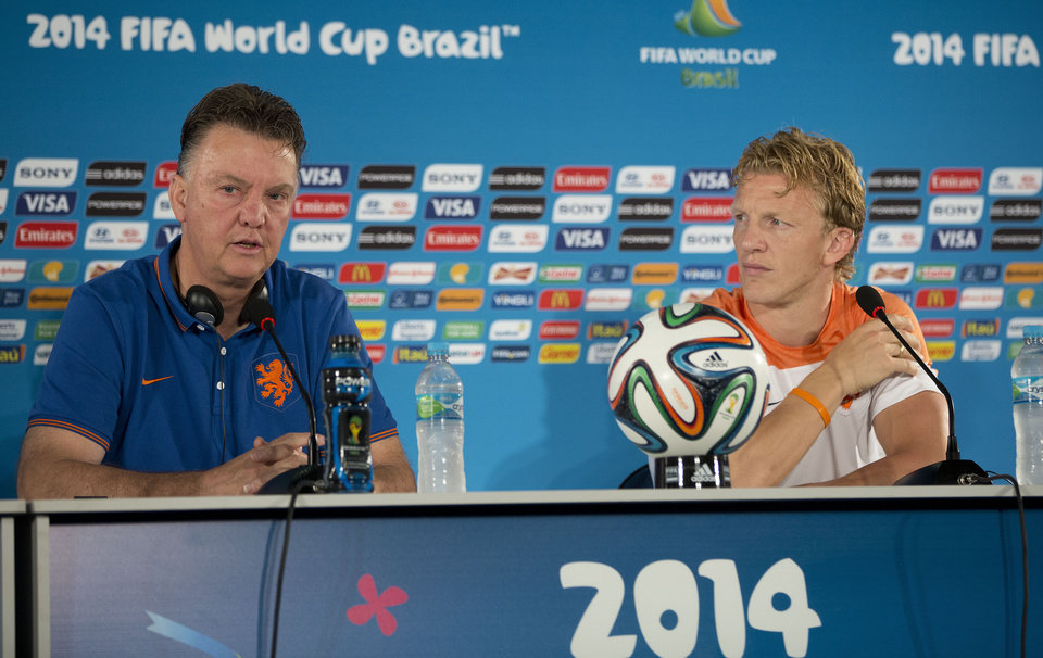 Photo - Netherlands head coach Louis van Gaal, left, speaks as player Dirk Kuyt  looks on during a news conference at the Estadio Nacional in Brasilia, Brazil, Friday, July 11, 2014. The Netherlands will face Brazil in the World Cup third-place match Saturday. (AP Photo/Andre Penner)