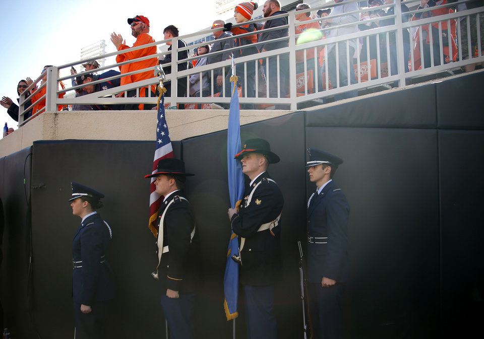 Photo - Oklahoma State ROTC members wait to walk onto  the field during the college football game between the Oklahoma State University Cowboys and the Kansas Jayhawks at Boone Pickens Stadium in Stillwater, Okla., Saturday, Nov. 16, 2019. OSU won 31-13. [Sarah Phipps/The Oklahoman]