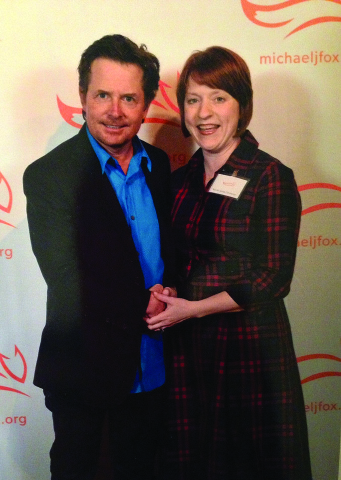 Michael J. Fox poses with Nicole Jarvis M.D. at an awards dinner hosted in New York by Fox, honoring the national Team Fox fundraising campaigns that raised the most money. Oklahoma\'s Team Fox raised $115,000 in 2012, which was 12th highest in the nation of all Team Fox events. Photo provided.