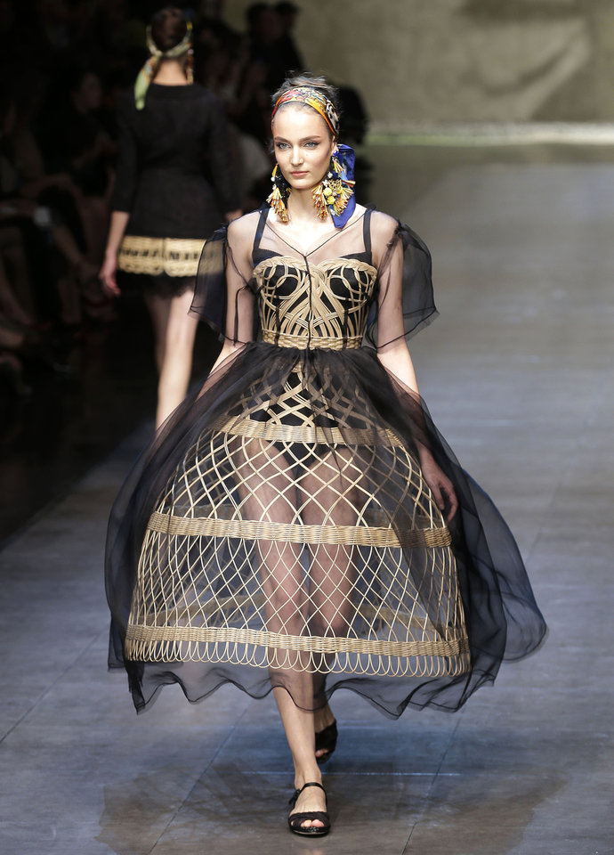 Photo -   A model wears a creation part of the Dolce & Gabbana women's Spring-Summer 2013 fashion collection, during the fashion week in Milan, Italy, Sunday, Sept. 23, 2012. (AP Photo/Antonio Calanni)