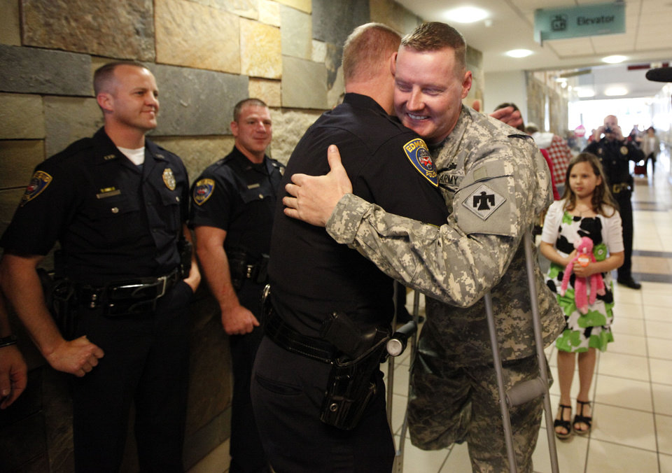 Edmond Police officer Jason Stearns welcomes home Edmond Police officer Kyle Stoy and Oklahoma National Guard soldier returns home at Will Rogers World Airport in  Oklahoma City, Thursday, March 22, 2012. Photo by Sarah Phipps, The Oklahoman.