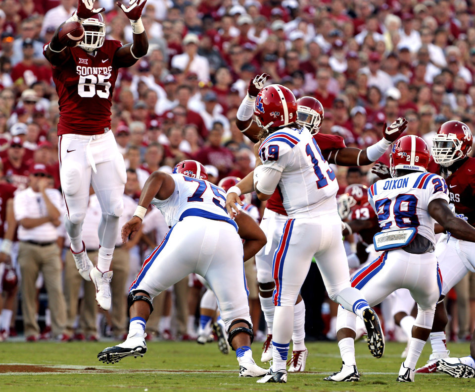 Photo - Oklahoma Sooners's Geneo Grissom (85) blocks a pass from Cody Sokol during a college football game between the University of Oklahoma Sooners (OU) and the Louisiana Tech Bulldogs at Gaylord Family-Oklahoma Memorial Stadium in Norman, Okla., on Saturday, Aug. 30, 2014. Photo by Steve Sisney, The Oklahoman