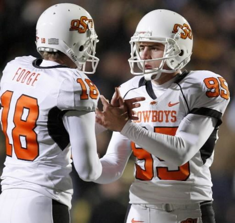 Photo - OSU's Dan Bailey, right, celebrates with Matt  Fodge after a field goal in the college football game between Oklahoma State University and the University of  Colorado at Folsom Field in Boulder, Colo., Saturday, Nov. 15, 2008. BY BRYAN TERRY, THE OKLAHOMAN