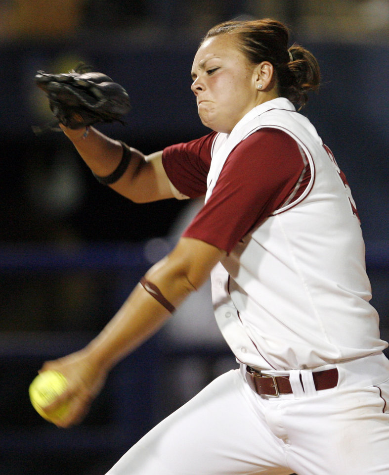 Photo - Charlotte Morgan (34) pitches for Alabama during the softball game in the Women's College World Series between Louisiana-Lafayette and Alabama at ASA Hall of Fame Stadium in Oklahoma City, Saturday, May 31, 2008. BY NATE BILLINGS, THE OKLAHOMAN