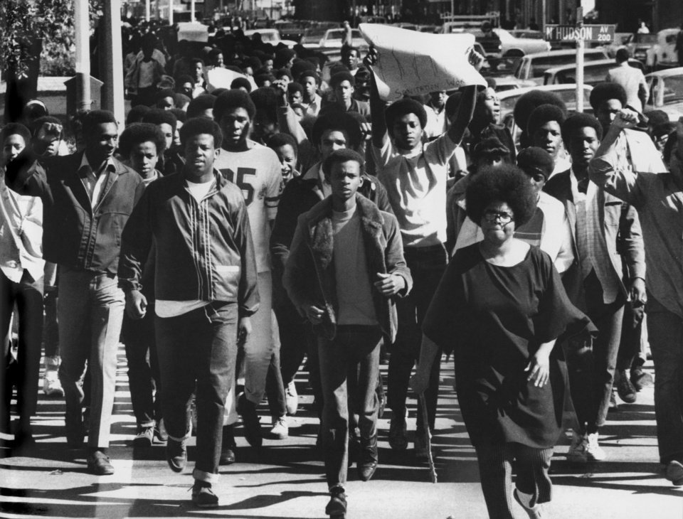 Photo - Douglass High School demonstrators march across Hudson in this undated photo from the 1960s. The protestors were heading west on Park Avenue to City Hall to show support for a city sanitation workers' strike.  GEORGE TAPSCOTT - THE OKLAHOMA CITY TIMES