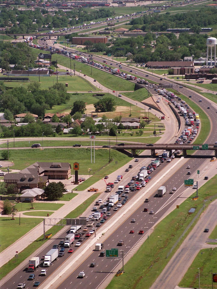 Aerial view, Tornado aftermath: Interstate 35 in Moore looking south from the 5th St. overpass at traffic backed up to Norman.