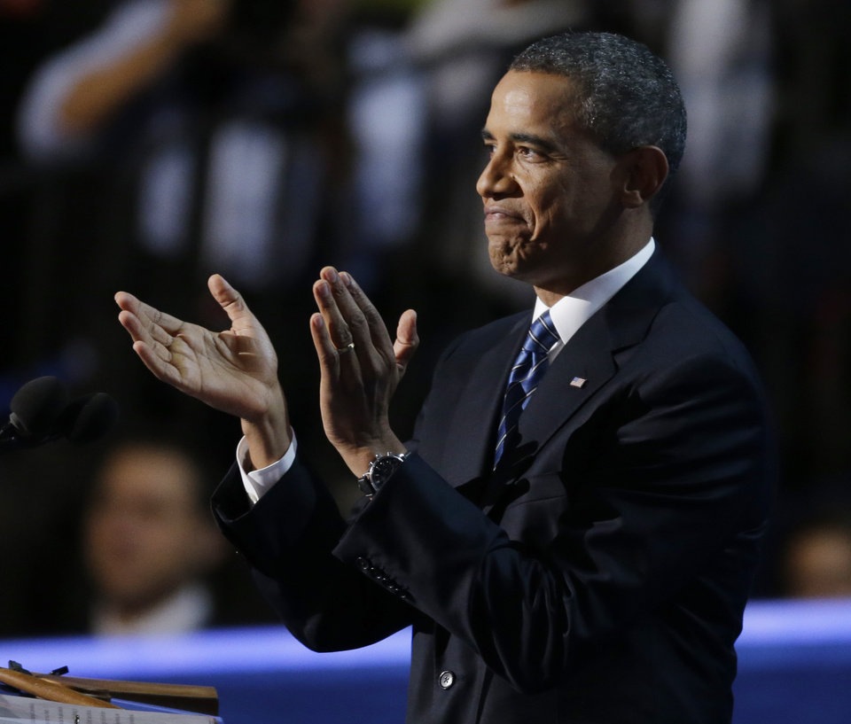 Photo -   President Barack Obama applauds before his speech to the Democratic National Convention in Charlotte, N.C., on Thursday, Sept. 6, 2012. (AP Photo/Lynne Sladky)