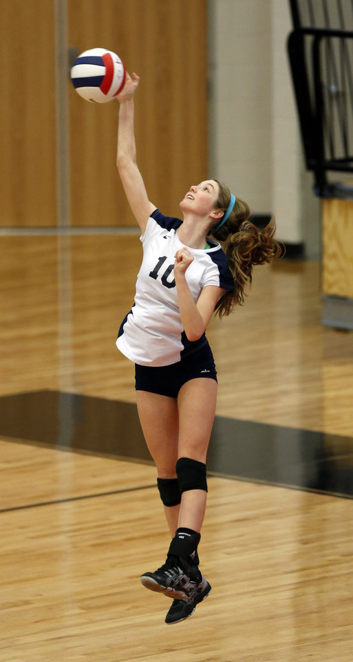 Photo - Heritage Hall's Gabby Helton serves against Lincoln Christian during the Class 5A State Championship volleyball tournament on Friday, Oct. 12, 2012, in Moore, Okla.  Photo by Steve Sisney, The Oklahoman