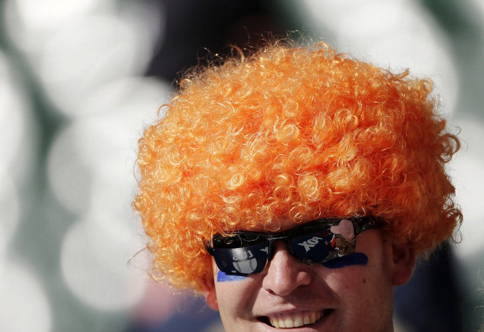 Photo -   A Detroit Tigers fans watches as the Detroit Tigers and New York Yankees prepare for Game 4 of the American League championship series Thursday, Oct. 18, 2012, in Detroit. (AP Photo/Charlie Riedel)