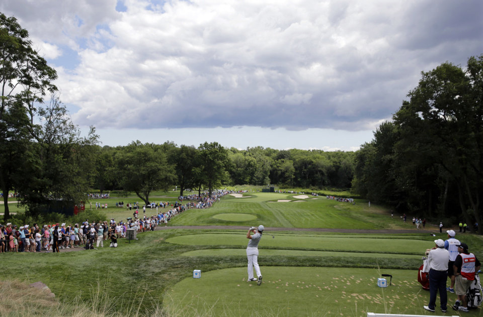 Photo - Rory McIlroy, of Northern Ireland, hits a shot on the eighth hole during the final round of play at The Barclays golf tournament Sunday, Aug. 24, 2014, in Paramus, N.J. (AP Photo/Mel Evans)