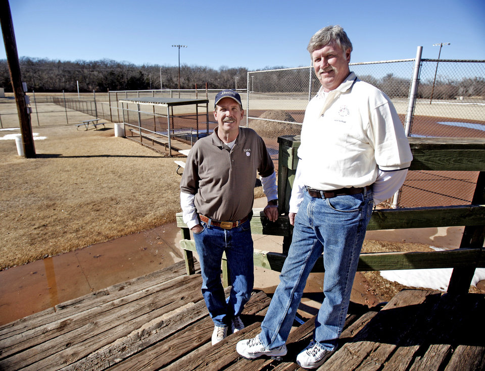 Pat Davis, left, and Ron Hood pose for a photo at the Bickham Softball complex,Sunday, Feb. 13, 2011, in Edmond, Okla. Photo by Sarah Phipps, The Oklahoman