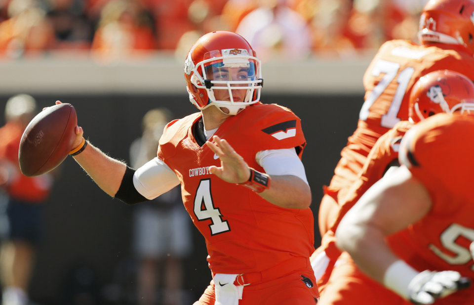 Photo - Oklahoma State's J.W. Walsh (4) passes the ball during a college football game between Oklahoma State University (OSU) and Iowa State University (ISU) at Boone Pickens Stadium in Stillwater, Okla., Saturday, Oct. 20, 2012. Photo by Nate Billings, The Oklahoman