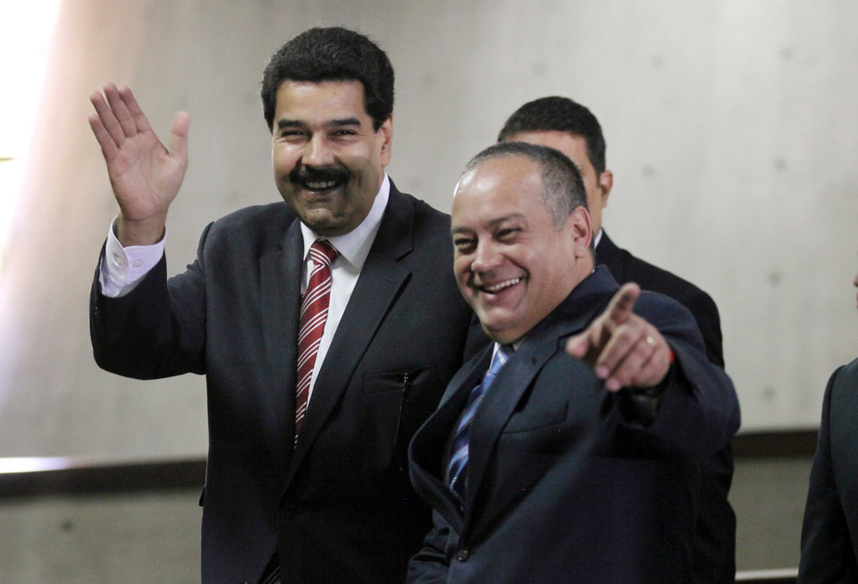 Photo - Venezuela's Vice President Nicolas Maduro, left, and National Assembly President Diosdado Cabello greet the media as they arrive to the Supreme Court for a special session marking the start of the judicial year in Caracas, Venezuela, Monday, Jan. 21, 2013. Maduro said Sunday he's optimistic that President Hugo Chavez will soon return to Venezuela following cancer-related surgery in Cuba. (AP Photo/Fernando Llano)