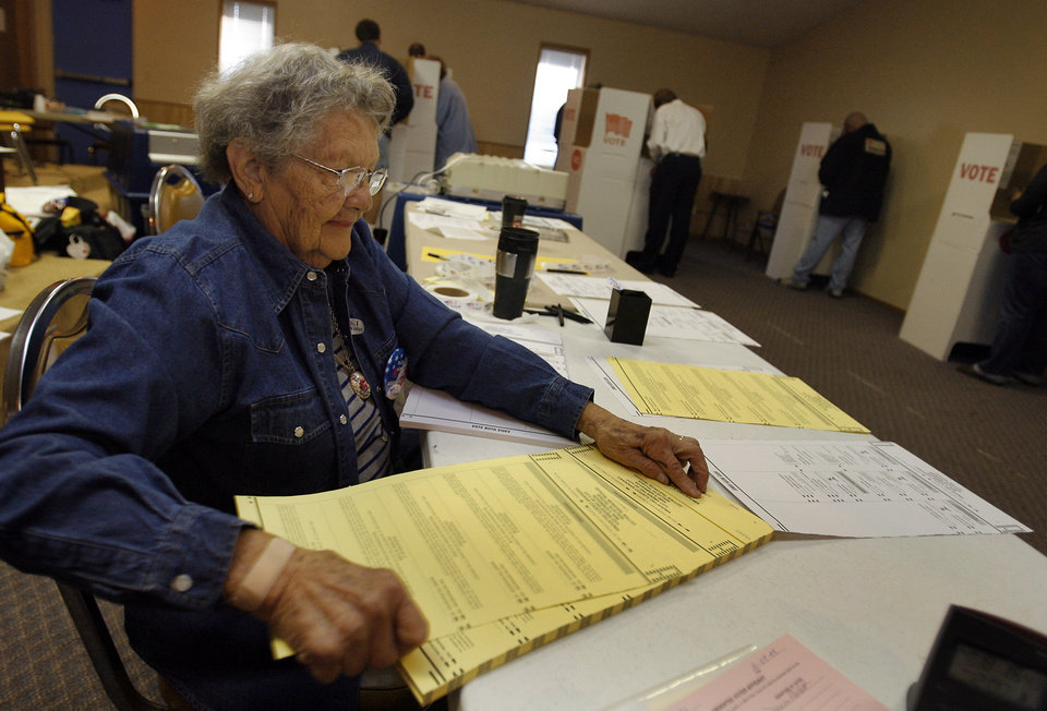 Photo - Polling volunteer Loretta Lovelace prepares ballots for voters during the Presidential election polling location at Canadian Hills Church of the Nazarene on Tuesday, Nov. 4, 2008, in Yukon, Okla.   BY CHRIS LANDSBERGER, THE OKLAHOMAN
