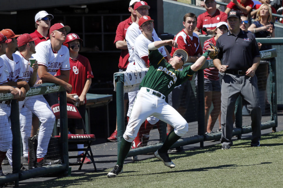 Photo - Baylor's Duncan Wendel (5) catches a pop foul in front of the Sooner dugout as the University of Oklahoma Sooner (OU) baseball team plays the Baylor Bears in college baeball at L. Dale Mitchell Park on May 3, 2014 in Norman, Okla. Photo by Steve Sisney, The Oklahoman
