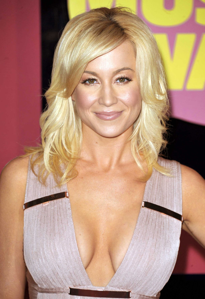Photo - FILE - This June 6, 2012 file photo shows singer Kellie Pickler at the 2012 CMT Music Awards in Nashville, Tenn. Pickler is one of eleven celebrity contestants who will compete on the next edition of