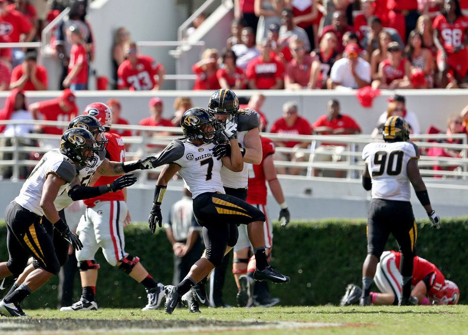 Photo - Missouri defensive back Randy Ponder (7) celebrates with teammates after he intercepted a Georgia pass during an NCAA college football game game at Sanford Stadium Saturday, Oct. 12, 2013. in Athens, Ga. (AP Photo/Atlanta Journal-Constitution, Jason Getz)