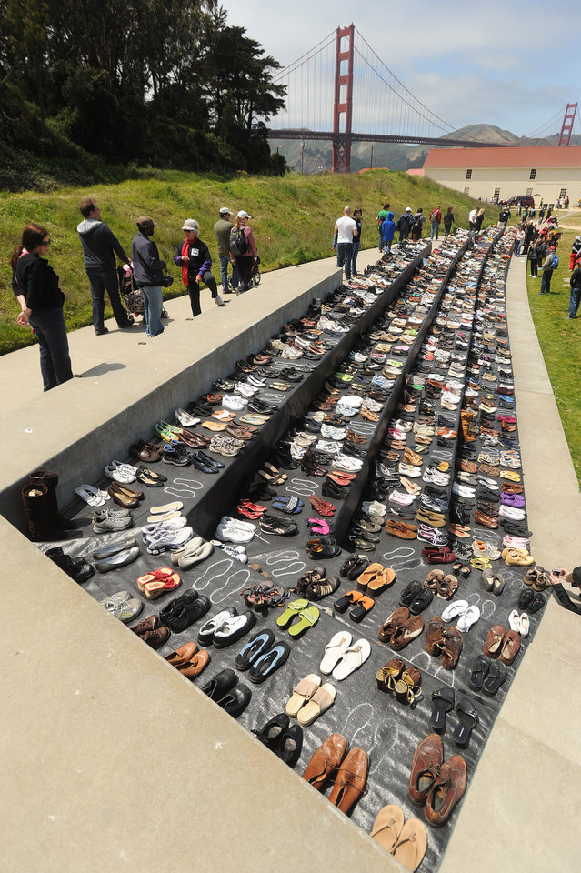 Photo -   An exhibit of shoes is displayed in remembrance of people who have jumped from the Golden Gate Bridge during a commemoration of the bridge's 75th anniversary on Sunday, May 27, 2012, in San Francisco. The Bridge Rail Foundation, which advocates for a safety net along the span to prevent suicides, estimates approximately 1,558 people have died after jumping since the bridge opened. (AP Photo/Noah Berger)