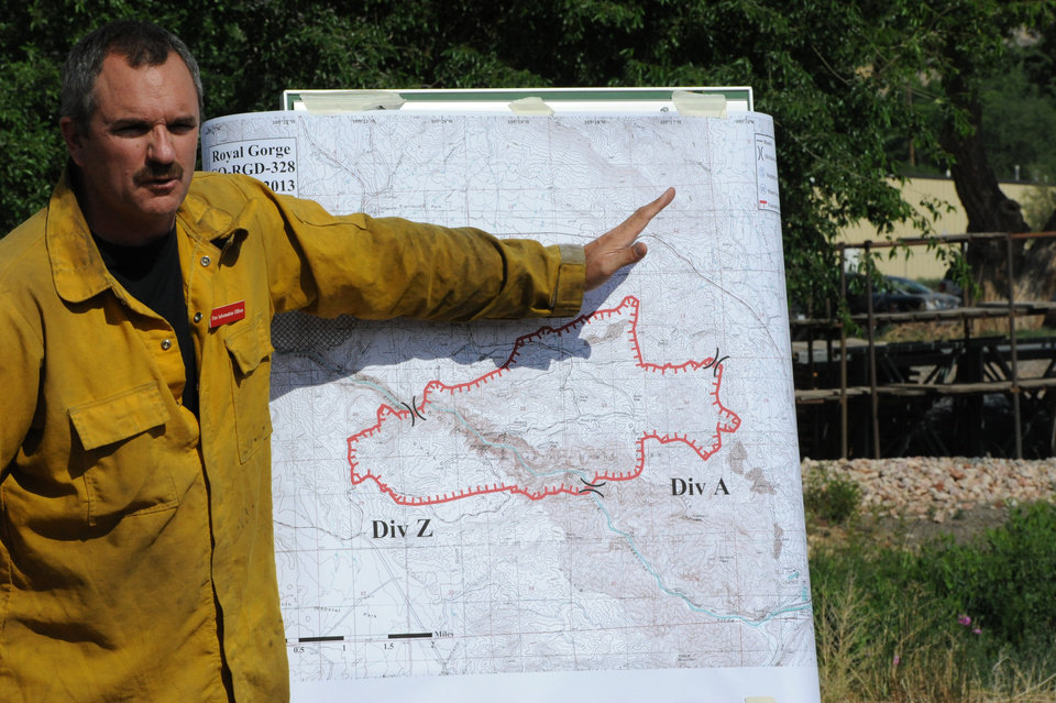 Photo - Gregg Goodland, fire information officer for the Royal Gorge Fire Department, explains the perimeter of the fire during a press conference Wednesday, June 12, 2013. (AP Photo/Daily Record, Michael Alcala)