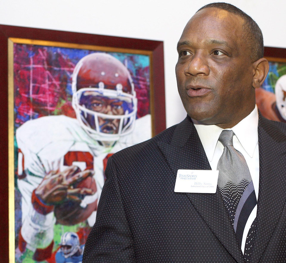 Photo - UNIVERSITY OF OKLAHOMA / OU: Former Oklahoma Heisman Trophy winner Billy Sims talks with the media in front of his portrait before induction ceremonies at the Texas Sports Hall of Fame Thursday Feb. 15, 2007, in Waco, Texas. Sims was inducted along with Cynthia Cooper, Roosevelt Leaks, Warren Moon, Rafer Johnson, Jerry Jones, Don Perkins, and DeLoss Dodds. (AP Photo/Waco Tribune-Herald, Duane A. Laverty) ORG XMIT: TXWAC104