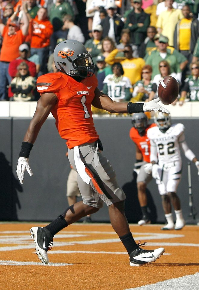 Photo - Oklahoma State's Joseph Randle (1) celebrates a touchdown during a college football game between the Oklahoma State University Cowboys (OSU) and the Baylor University Bears (BU) at Boone Pickens Stadium in Stillwater, Okla., Saturday, Oct. 29, 2011. Photo by Sarah Phipps, The Oklahoman