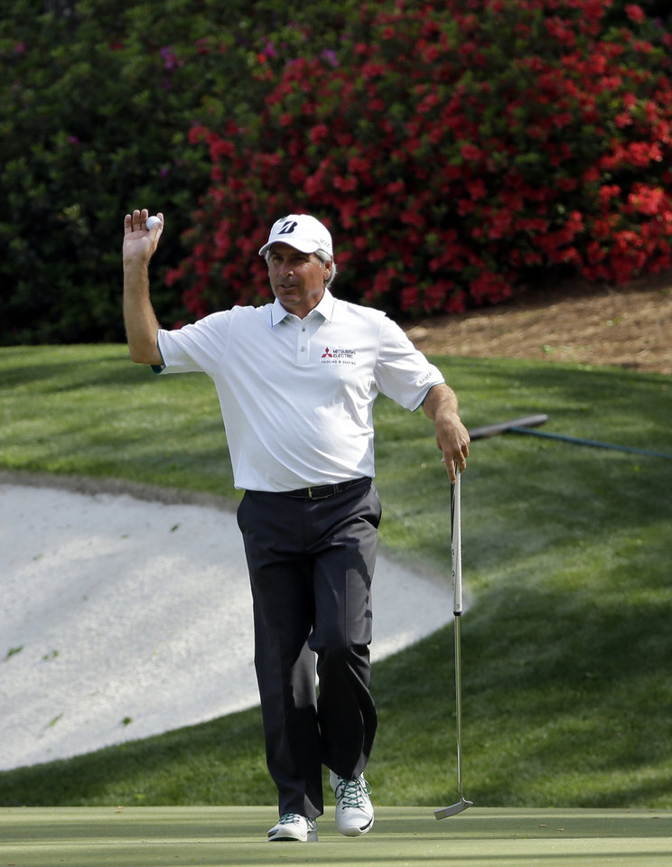 Photo - Fred Couples holds up his ball after a birdie on the 13th hole during the second round of the Masters golf tournament Friday, April 11, 2014, in Augusta, Ga. (AP Photo/David J. Phillip)