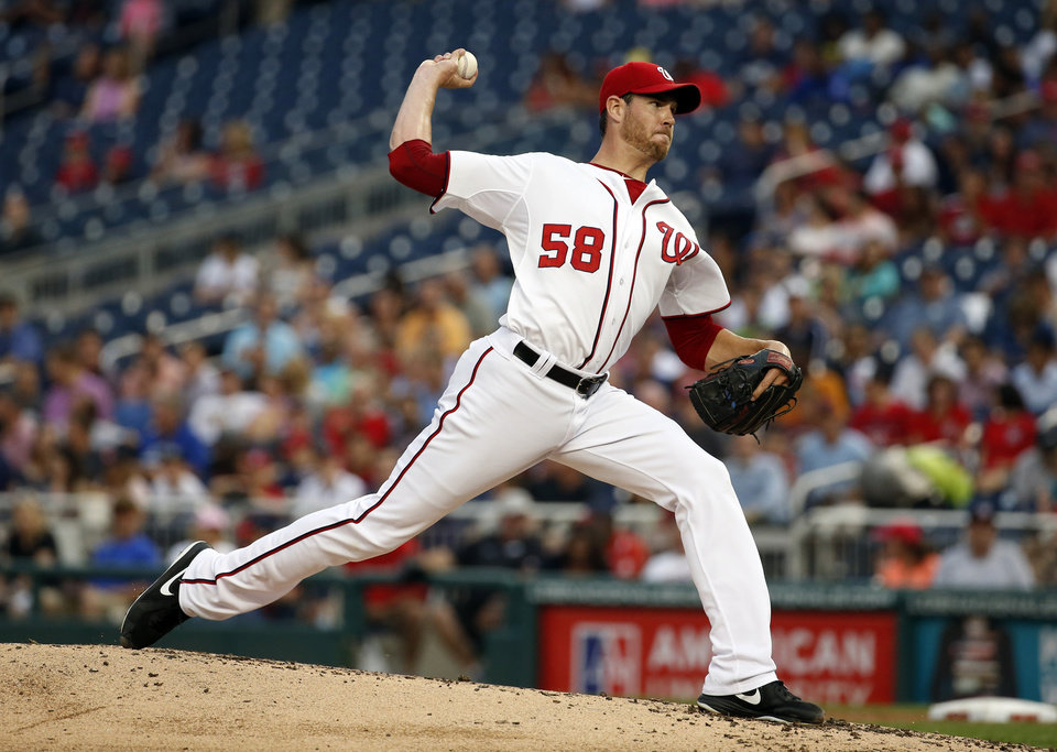 Photo - Washington Nationals starting pitcher Doug Fister throws during the third inning of a baseball game against the New York Mets at Nationals Park Wednesday, Aug. 6, 2014, in Washington. (AP Photo/Alex Brandon)