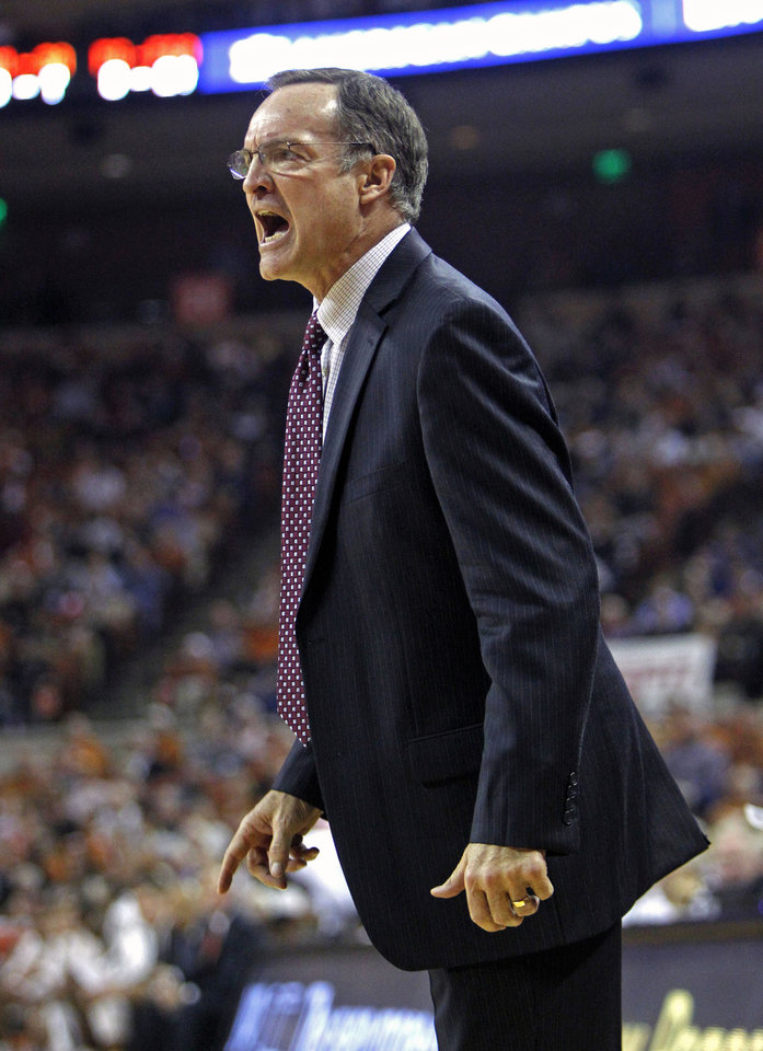 Photo - Oklahoma head coach Lon Kruger calls out to his team during the first half an NCAA college basketball game against Texas, Monday, Jan. 5, 2015, in Austin, Texas. Oklahoma won 70-49. (AP Photo/Michael Thomas)