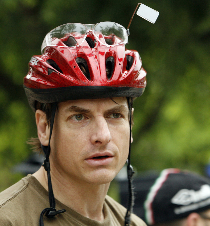Photo - Hans Rose listens to the program during Bike to Work day in Norman, Okla. on Friday, May 1, 2009.   Photo by Steve Sisney, The Oklahoman