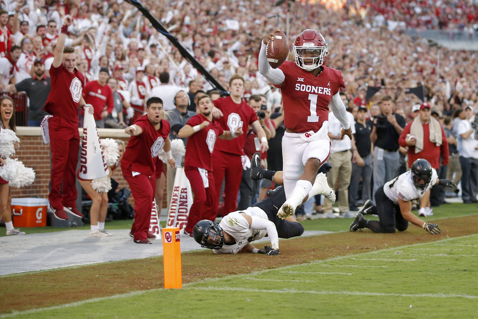 Photo - Oklahoma's Kyler Murray (1) leaps for a touchdown during a college football game between the University of Oklahoma Sooners (OU) and the Army Black Knights at Gaylord Family-Oklahoma Memorial Stadium in Norman, Okla., Saturday, Sept. 22, 2018. Photo by Bryan Terry, The Oklahoman