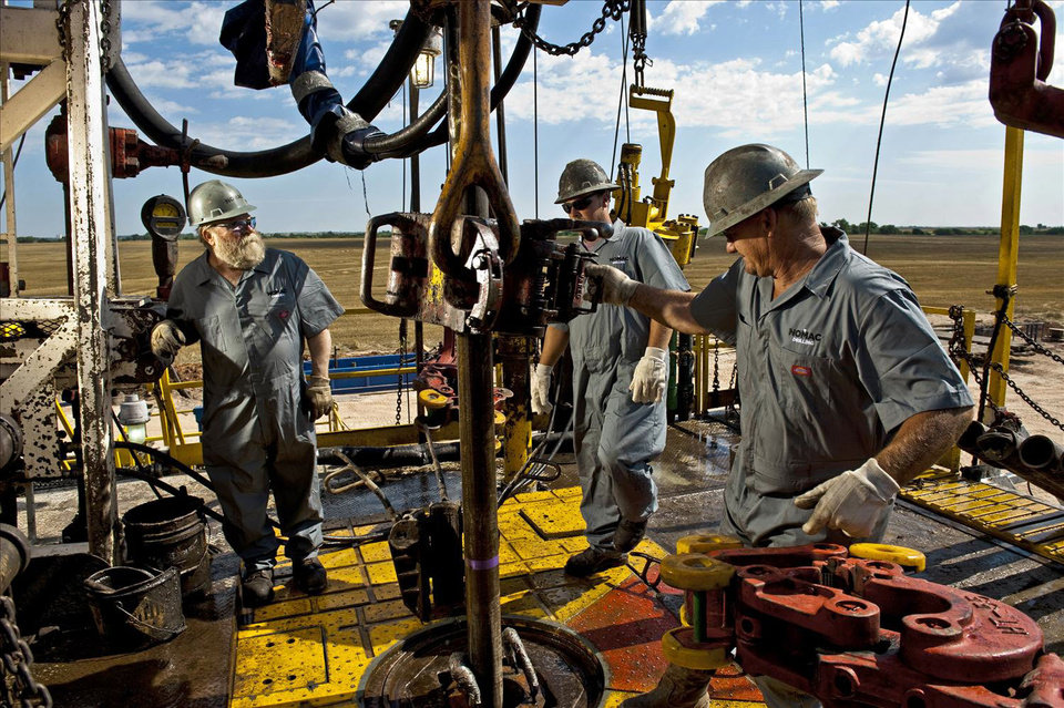 Workers with Chesapeake Energy Corp. subsidiary Nomac Drilling work on a rig near Alva in far northern Oklahoma in June 2009.  Chesapeake on Monday announced a joint venture in which it sold part of its prodcution in the Mississippi Lime of northern Oklahoma to Chinese oil comapny Sinopec. <strong>PROVIDED - Photo provided</strong>