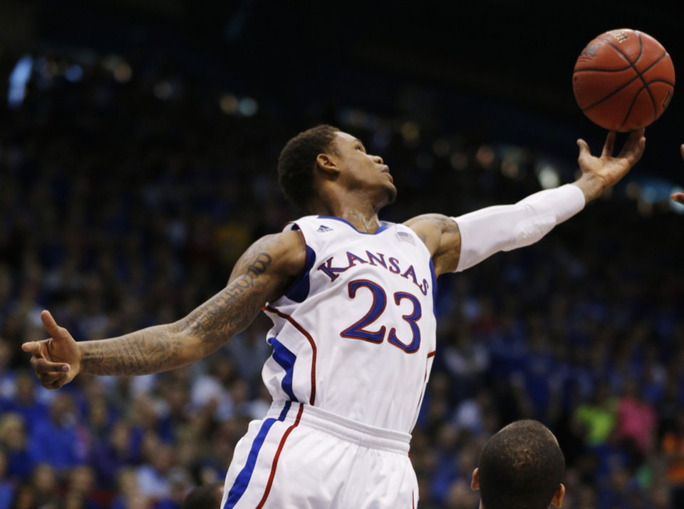 Kansas guard Ben McLemore (23) rebounds during the second half of an NCAA college basketball game against Oklahoma in Lawrence, Kan., Saturday, Jan. 26, 2013. Kansas won 67-54. (AP Photo/Orlin Wagner) ORG XMIT: KSOW108