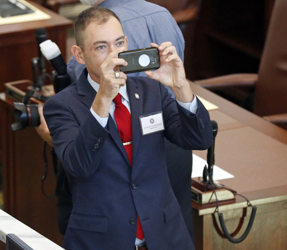 Photo - Rep. Judd Strom takes a photo of the gallery before the oath of office ceremony for newly-elected members of the Oklahoma House of Representatives in the House chamber at the state Capitol in Oklahoma City, Nov. 15, 2018. Photo by Nate Billings, The Oklahoman