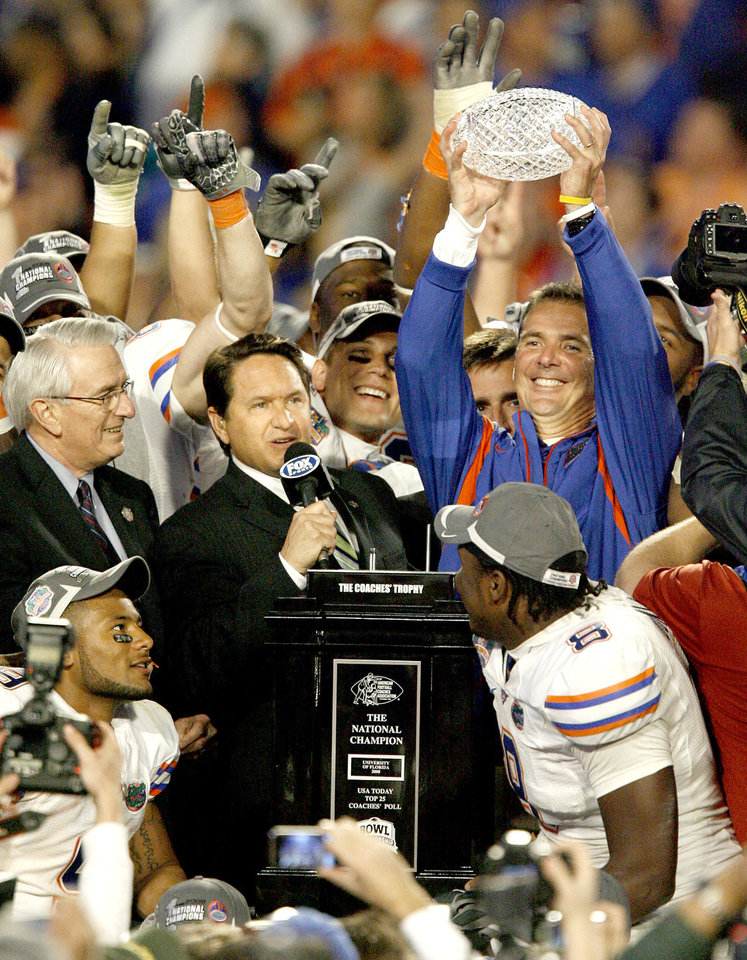 Photo - Florida coach Urban Meyer holds the National Championship Trophy after Florida's 24-14 win over OU in the BCS National Championship college football game between the University of Oklahoma Sooners (OU) and the University of Florida Gators (UF) on Thursday, Jan. 8, 2009, at Dolphin Stadium in Miami Gardens, Fla. 