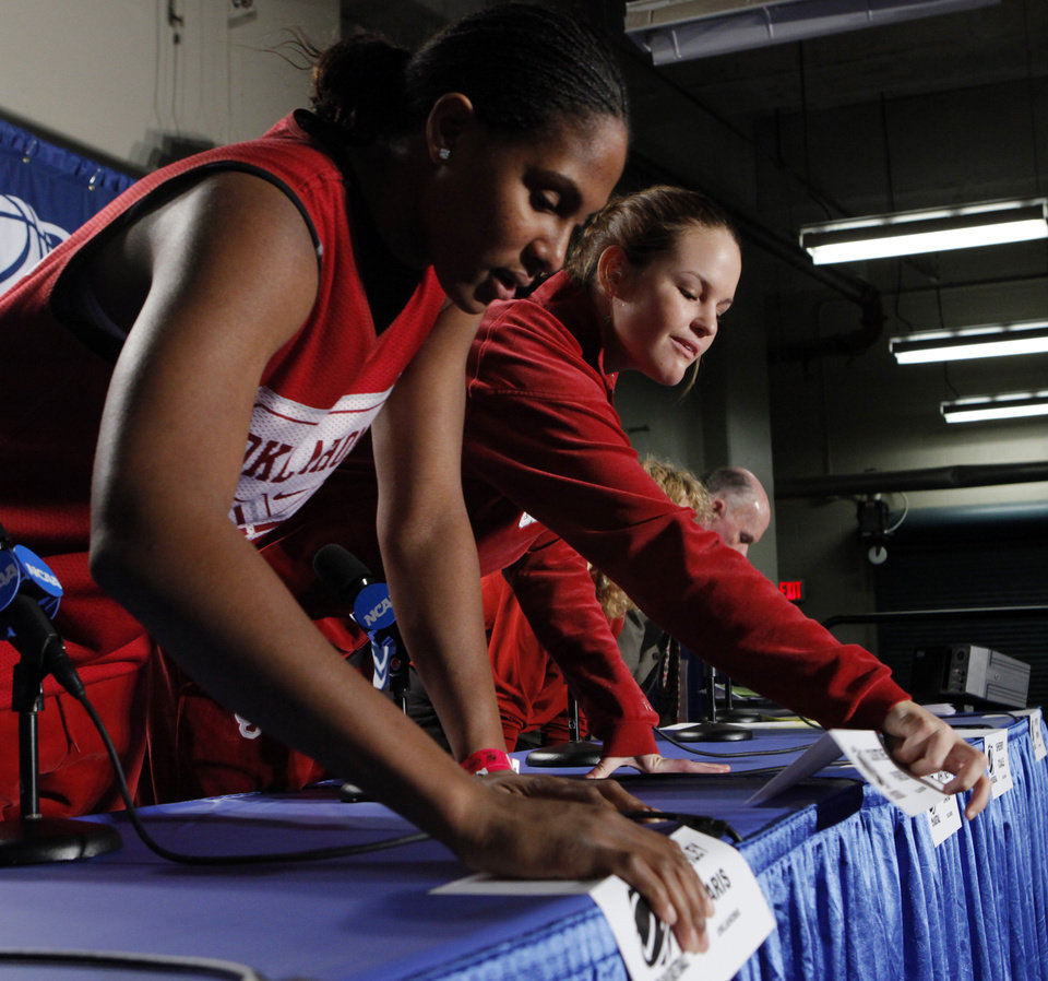 University of Oklahoma team members Ashley Paris and Whitney Hand check their seating order as they prepare to speak to the media before the Sooners elite eight appearance in NCAA women\'s basketball tournament at the Ford Center in Oklahoma City, Okla. on Monday, March 30, 2009. PHOTO BY STEVE SISNEY, THE OKLAHOMAN