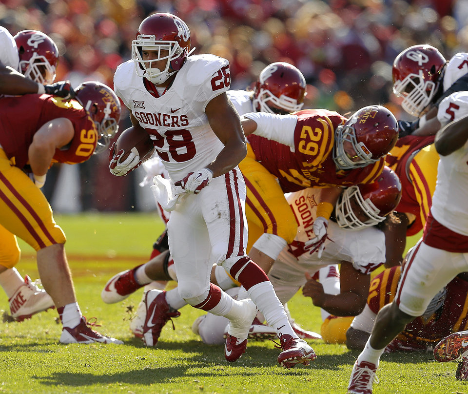 Photo - Oklahoma's Alex Ross (28) runs during a college football game between the University of Oklahoma Sooners (OU) and the Iowa State Cyclones (ISU) at Jack Trice Stadium in Ames, Iowa, Saturday, Nov. 1, 2014. Photo by Bryan Terry, The Oklahoman