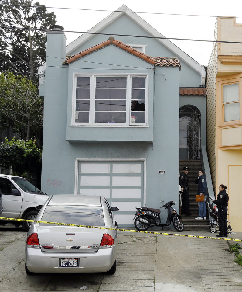 Photo - San Francisco police enter the home of a woman who was set on fire Sunday, Jan. 6, 2013, in San Francisco. San Francisco police say a woman is hospitalized with what are being described as