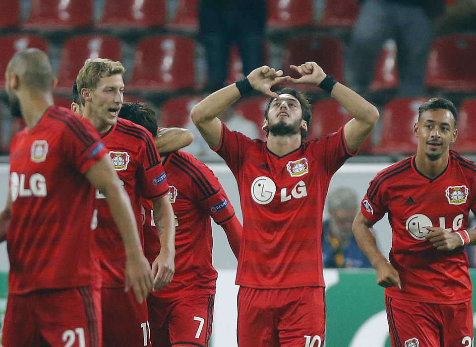 Photo - Leverkusen's Hakan Calhanoglu, center, celebrates after scoring during the Champions League qualifying soccer match between Bayer 04 Leverkusen and FC Copenhagen in Leverkusen, Germany, Wednesday, Aug. 27, 2014. (AP Photo/Frank Augstein)