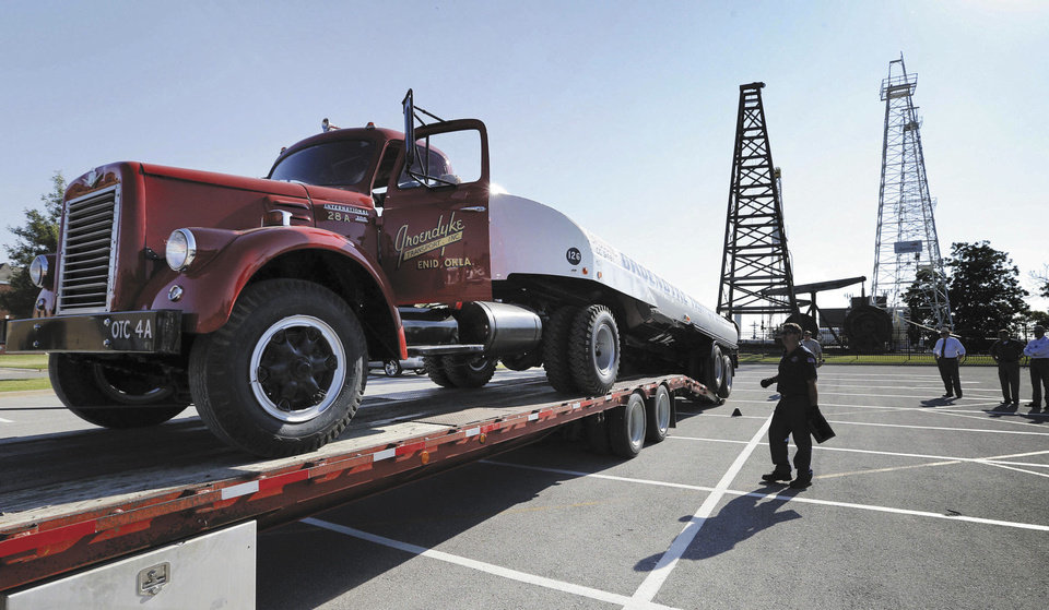 Photo - A 1963 International Tanker Truck donated by Groendyke Trucking is unloaded for permanent display at the Oklahoma History Museum on Wednesday, Sept. 4, 2013, in Oklahoma City, Okla.  Photo by Steve Sisney, The Oklahoman