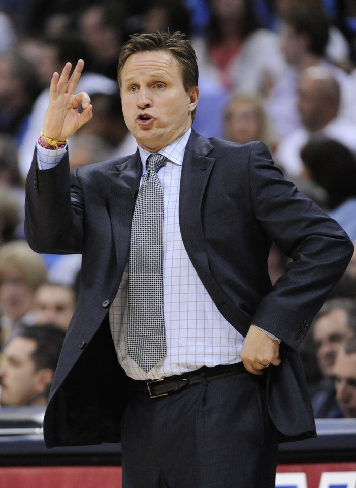 Photo - Oklahoma City Thunder head coach Scott Brooks signals to his team during the first half in game 4 of a first-round NBA basketball playoff series against the Denver Nuggets Monday, April 25, 2011, in Denver. (AP Photo/Jack Dempsey)
