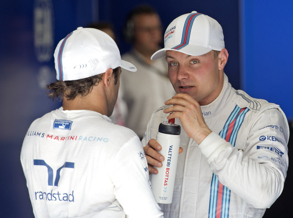 Photo - Williams driver Valtteri Bottas, right, of Finland, right, talks with Williams driver Felipe Massa, left, of Brazil after the qualification at the German Formula One Grand Prix in Hockenheim, Germany, Saturday, July 19, 2014. Mercedes driver Nico Rosberg of Germany clocked the fastest time ahead of second fastest Botas and third Massa. The German Grand Prix will be held on Sunday, July 20, 2014. (AP Photo/Jens Meyer)