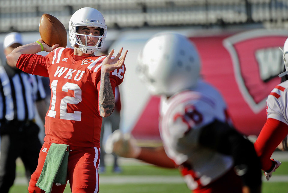 Photo - In this April 12, 2014 photo, Western Kentucky quarterback Brandon Doughty prepares to throw a pass during practice at Houchens-Smith Stadium in Bowling Green, Ky. (AP Photo/Daily News, Alex Slitz)