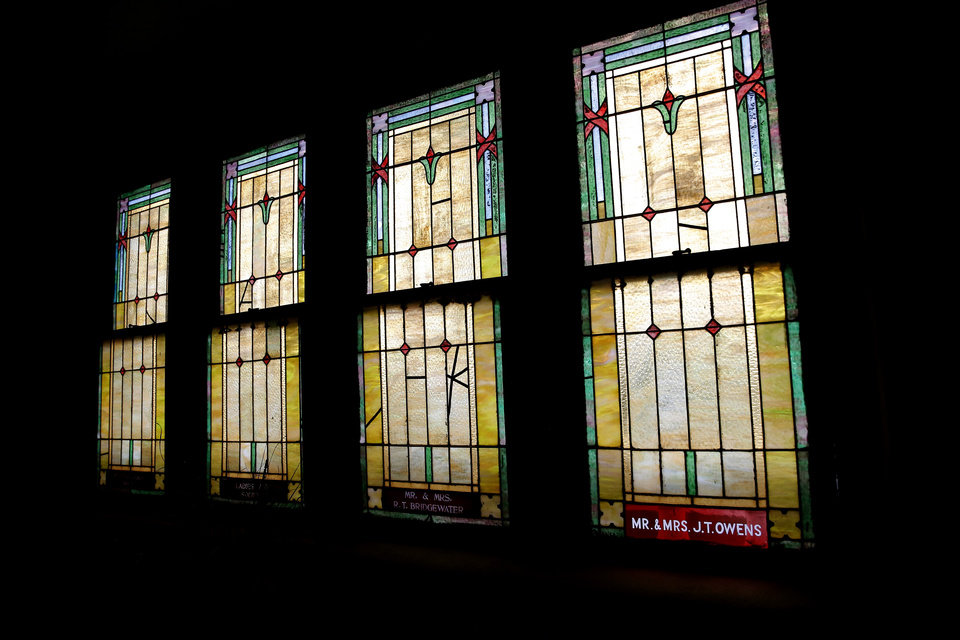 Photo - Stained-glass windows are pictured at the Vernon A.M.E Church in the Greenwood district in Tulsa, Okla., Wednesday, July 22, 2020. Photo by Sarah Phipps, The Oklahoman