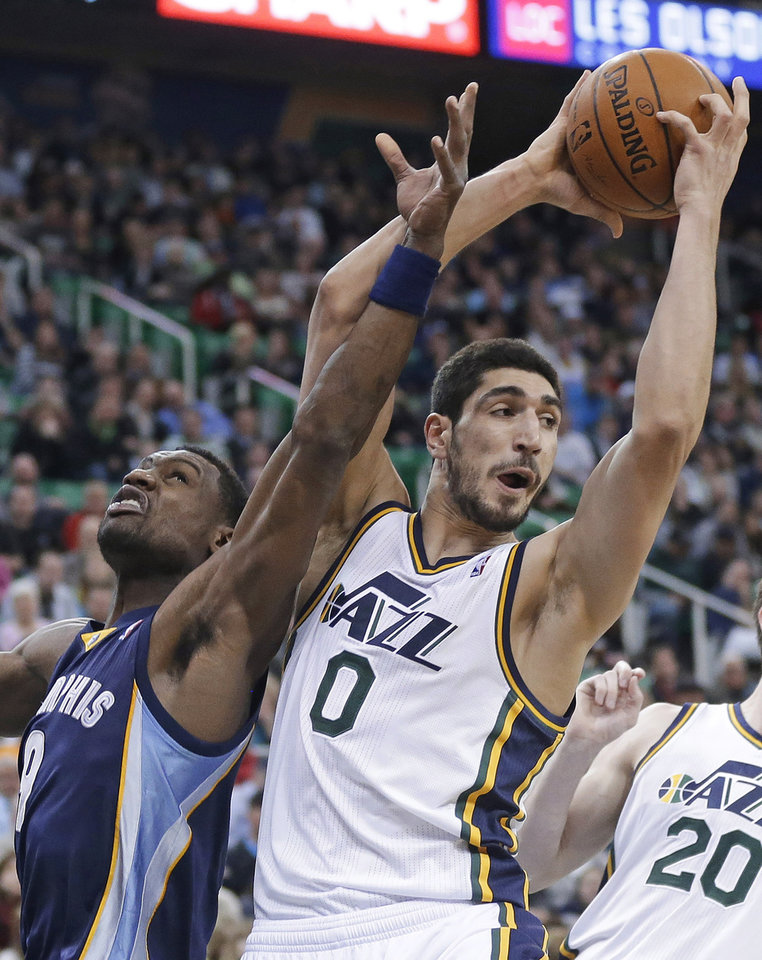 Photo - Utah Jazz's Enes Kanter (0), of Turkey, pulls down a rebound as Memphis Grizzlies' Tony Allen (9) defends during the second quarter of an NBA basketball game Wednesday, March 26, 2014, in Salt Lake City. (AP Photo/Rick Bowmer)