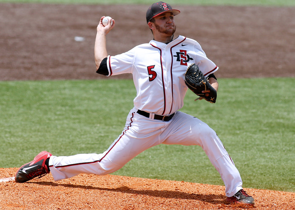 Photo - San Diego State pitcher Bubba Derby throws in the first inning of an NCAA college baseball tournament regional game against Louisiana-Lafayette in Lafayette, La., Saturday, May 31, 2014. (AP Photo/Jonathan Bachman)