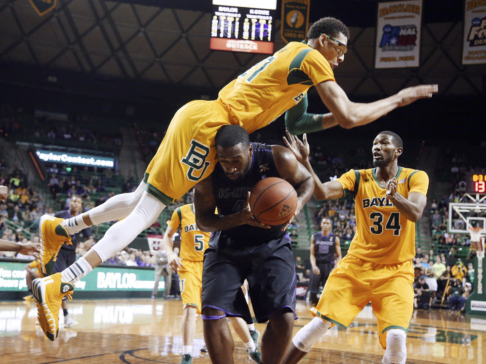 Photo - Baylor center Isaiah Austin, top, falls on Kansas State forward Thomas Gipson, bottom, as Baylor forward Cory Jefferson (34) stands at right in the first half of an NCAA college basketball game, Saturday, Feb. 15, 2014, in Waco, Texas. (AP Photo/The Waco Tribune-Herald, Rod Aydelotte)