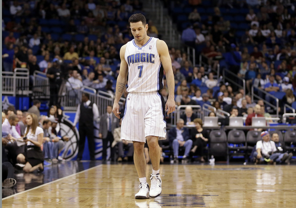 Orlando Magic's J.J. Redick (7) walks down the court during the first half of an NBA basketball game against the Charlotte Bobcats in Orlando, Fla., Tuesday, Feb. 19, 2013. The Bobcats won 105-92.  (AP Photo/Willie J. Allen Jr.)
