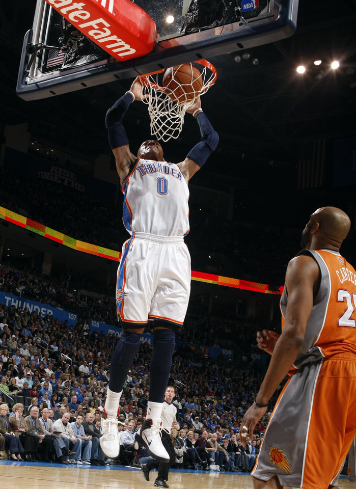 Photo - Oklahoma City's Russell Westbrook (0) dunks in front of Phoenix's Vince Carter (25) during the NBA game between the Oklahoma City Thunder and the Phoenix Suns, Sunday, March 6, 2011, the Oklahoma City Arena. Photo by Sarah Phipps, The Oklahoman.