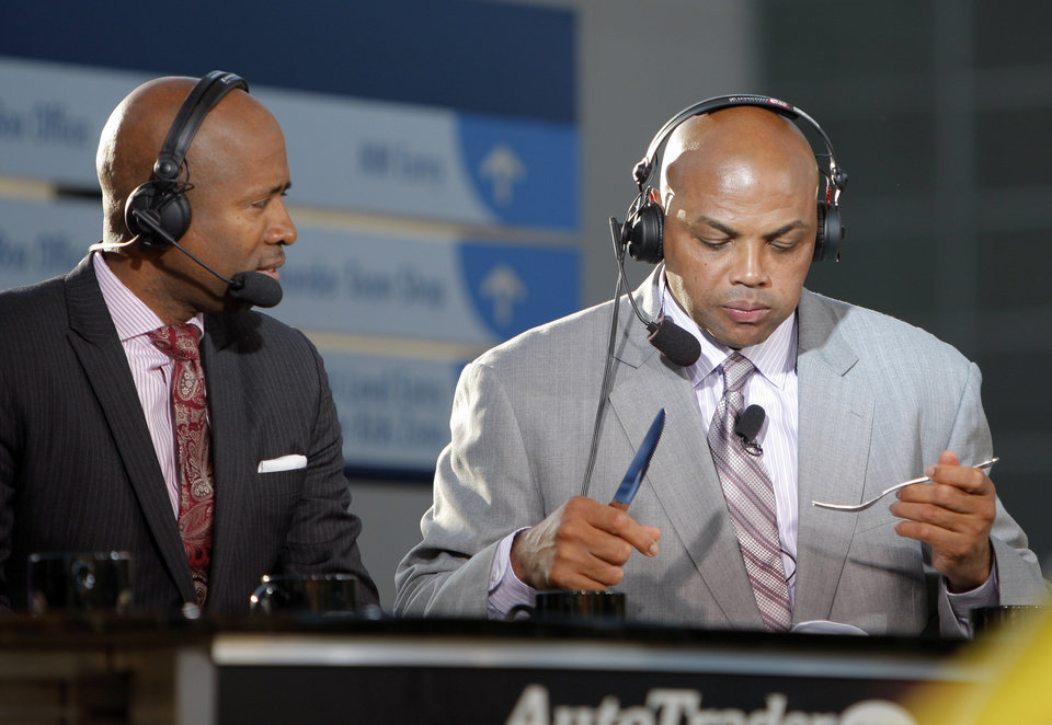 Photo - Charles Barkley eats a dinner courtesy of  Gov. Mary Fallin during game three of the Western Conference Finals in the NBA playoffs between the Oklahoma City Thunder and the San Antonio Spurs at Chesapeake Energy Arena in Oklahoma City, Thursday, May 31, 2012. Photo by Sarah Phipps, The Oklahoman