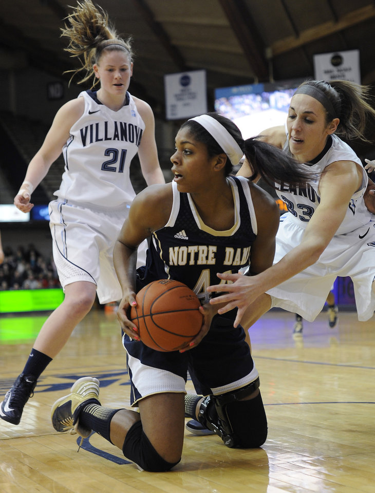 Photo - Notre Dame's Ariel Baker (44) grabs a loose ball in front of Villanova's Laura Sweeney (33) and Lauren Burford (21) during the first half of an NCAA college basketball game, Tuesday, Feb. 5, 2013, in Villanova, Pa.  (AP Photo/Michael Perez)